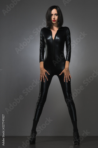 woman in latex suit on a dark background Canvas-taulu