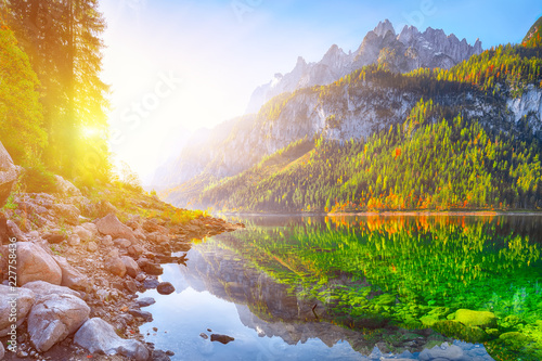Poster Reflexion autumn scenery with Dachstein mountain summit reflecting in crystal clear Gosausee mountain lake