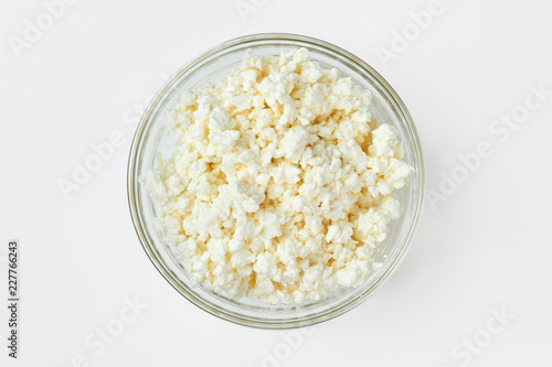 Fresh cottage cheese in glass bowl. Healthy natural dairy product. Dairy products and diet.