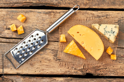 Cheese on wooden boards. Milk products on rustic wood. Delicious milk snack.