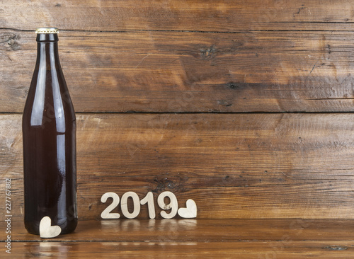 Tuinposter Bier / Cider Fresh beer in glass bottles on wooden background