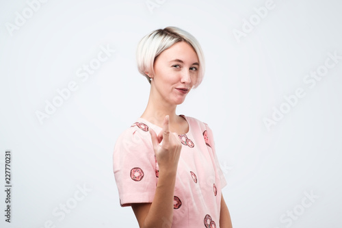 Woman gesturing come here calling you isolated on a white background Wallpaper Mural