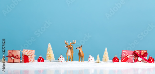 Christmas holiday theme with reindeer and Christmas trees