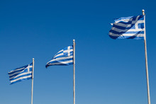 Three Greek Flags And A Blue Sky