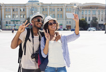 Happy African-american Tourists Taking Selfie In New City