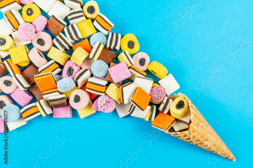 Waffle Cone With Colored Licorice Candys on light blue background