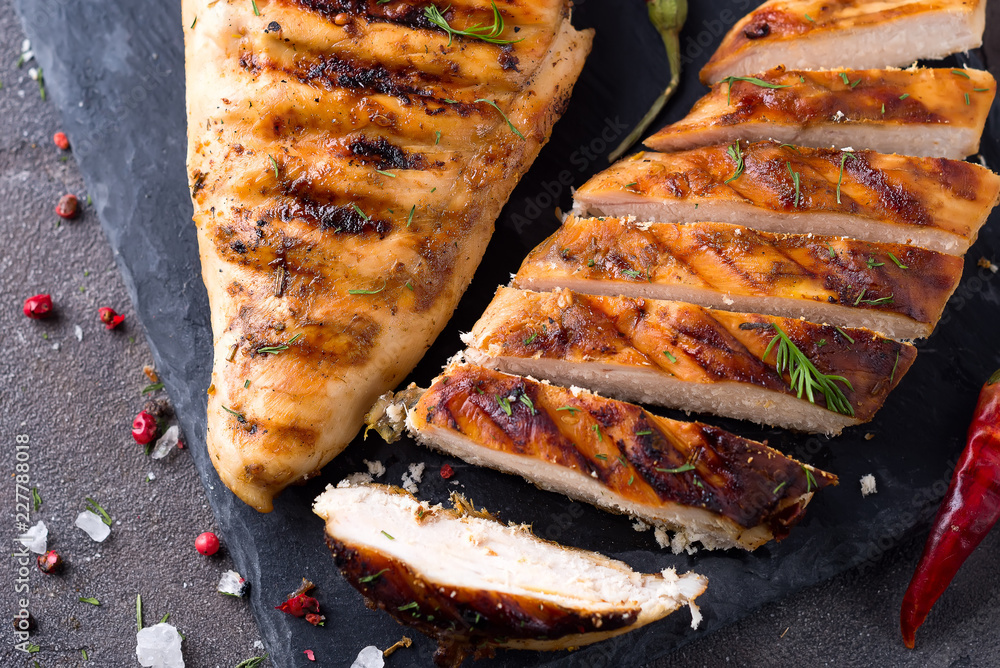 Fototapety, obrazy: Grilled chicken fillets on slate plate on Gray concrete background. Healthy diet food concept, flat lay close up