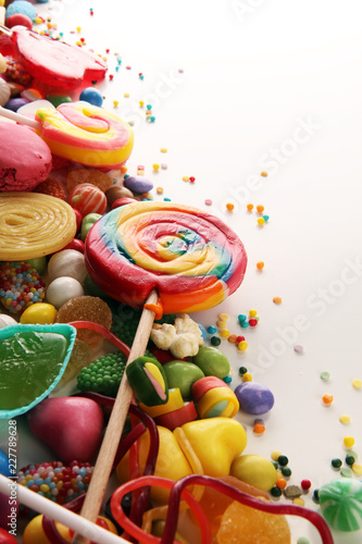 Poster Confiserie candies with jelly and sugar. colorful array of different childs sweets and treats.