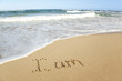 word written in sand on the beach