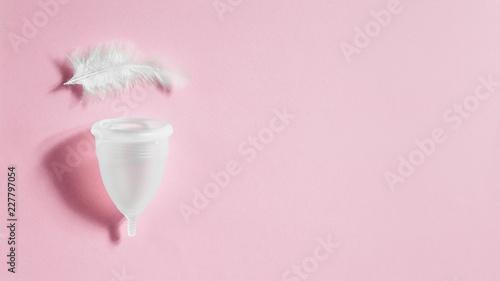 Fotografía  Menstrual cup on pink background, feminine hygiene