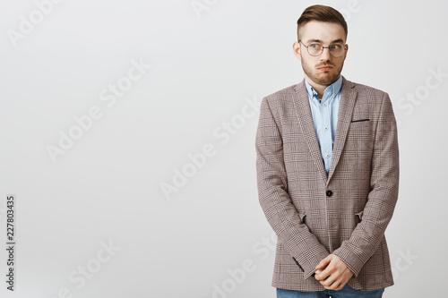 Stampa su Tela  Intense worried european male employee feeling awkward and confused making mista