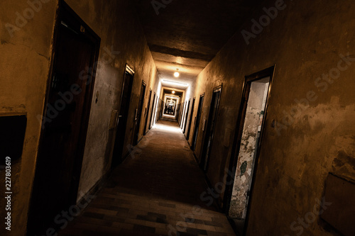 An old corridor of a creepy prison abandoned a long time ago. Poster Mural XXL