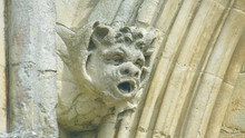 Corbel Head On The West Front Of Salisbury Cathedral F, Gargoyle On Early English Gothic Cathedral, Shallow Depth Of Field Split Toning Horizontal Photography