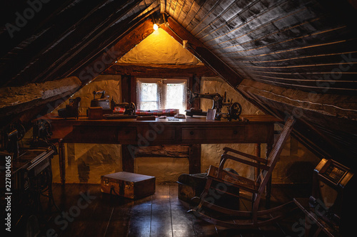 Obraz na plátně An old attic with antique furniture