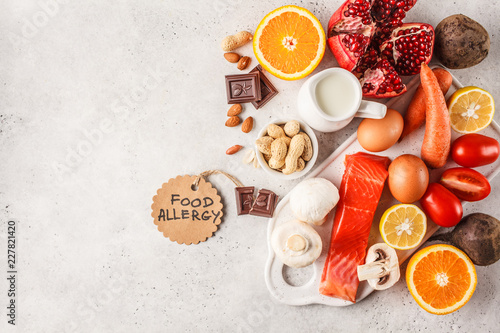 Allergy food concept. Allergies to fish, eggs, citrus fruits, chocolate, mushrooms and nuts.
