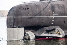 Ducks Swim On The Background Of The Engine Of The Russian Submarine