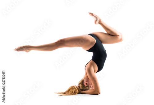 Recess Fitting Gymnastics Young blonde woman in maillot practicing yoga lesson