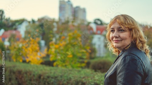 Fototapety, obrazy: A woman aged posing on the background of the autumn landscape