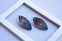 Tribal Spiral Earrings Of Polymer Clay In Empty Frame. Trendy Fashion Jewelry Background.