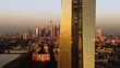 Frankfurt ECB Skyline Aerial Shot at early sunrise reflecting sun