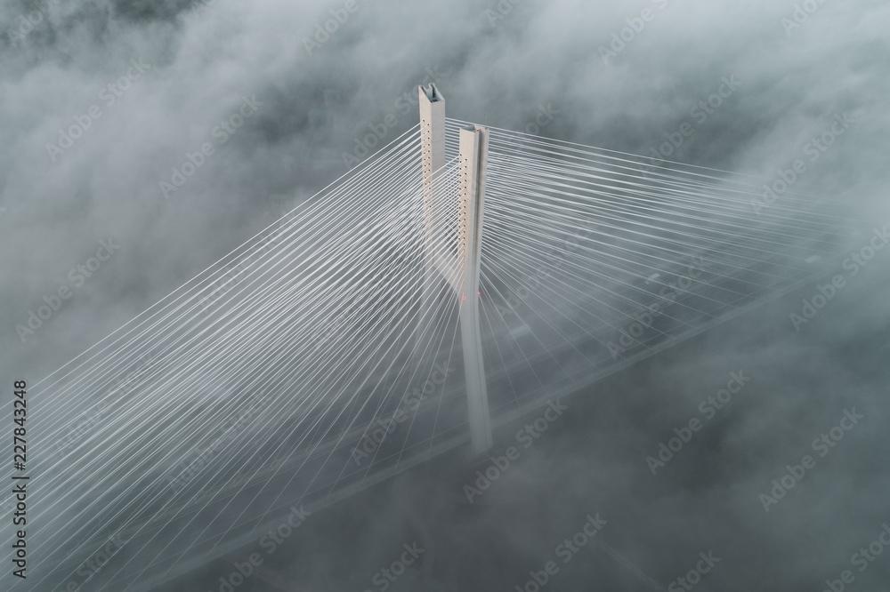 Fototapeta Redzinski bridge in the clouds aerial view