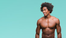 Afro American Shirtless Man Showing Nude Body Over Isolated Background Looking Away To Side With Smile On Face, Natural Expression. Laughing Confident.