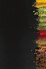 Indian Condiments On Black Table In High Resolution. Spices For Cooking Food On Background Of Chalkboard With Empty Space.