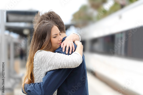 Sad couple saying goodbye before travel