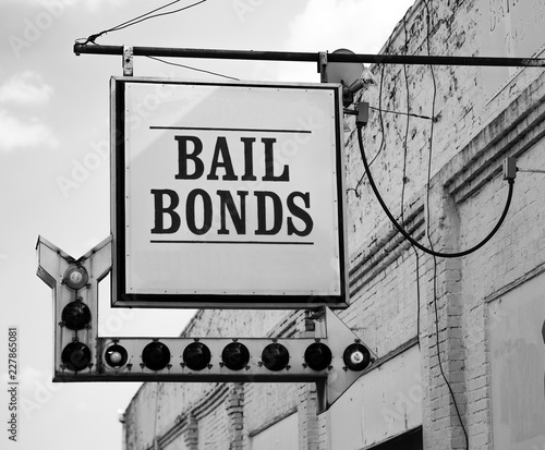 Aging Vintage Sign in Front of Samll Town Bail Bonds Office Canvas Print