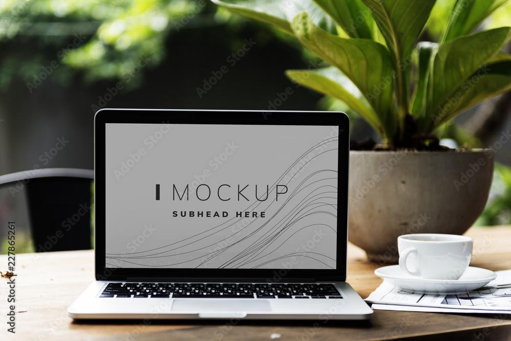 Fototapeta Laptop in a garden with a screen mockup