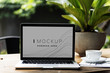 canvas print picture - Laptop in a garden with a screen mockup