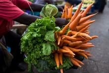 Man Selling Fresh Carrots In M...