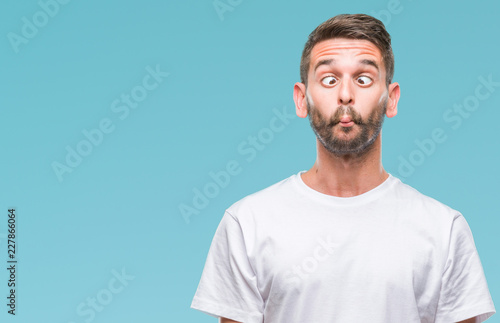 Fotografie, Obraz Young handsome man over isolated background making fish face with lips, crazy and comical gesture