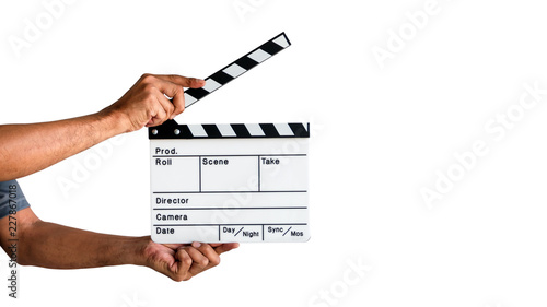 Fényképezés Hand holding a film clapboard slate or movie slate isolated on white background, with clipping path