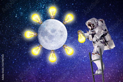 astronaut replaces a light bulb.elements of this image furnished by NASA