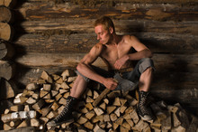 Woodcutter Sitting On A Pile O...