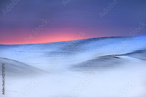 Fototapeta Snow covered wheat fields at sunset in Washington state - abstract
