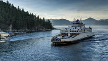 Ferry Approaches The Shores Carrying Vehicles And Passengers. Beautiful British Columbia, Canada.