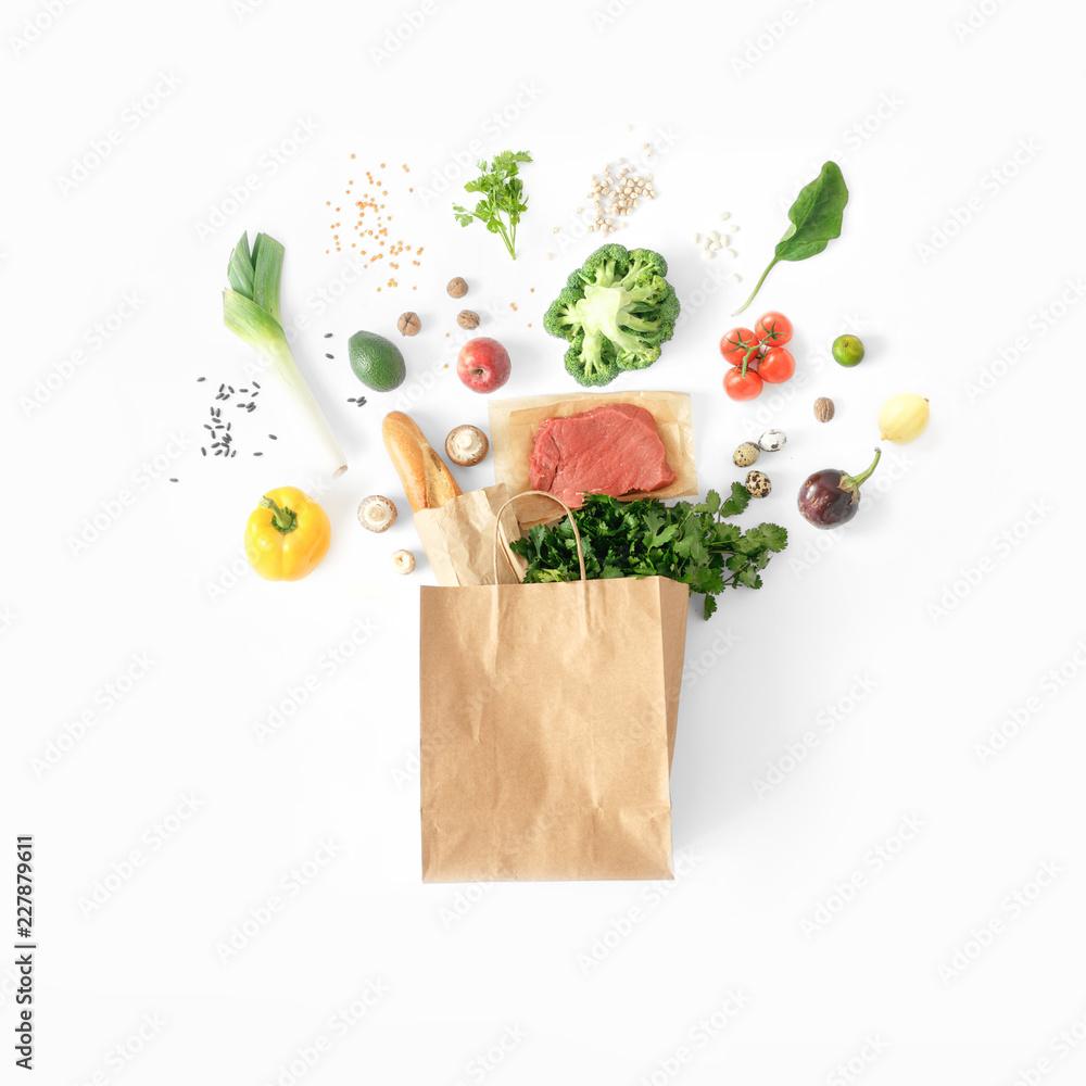 Fototapeta Healthy eating background top view Full paper bag healthy food