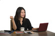 isolated portrait of young beautiful and happy successful Asian Korean business woman working relaxed at office computer desk smiling sweet