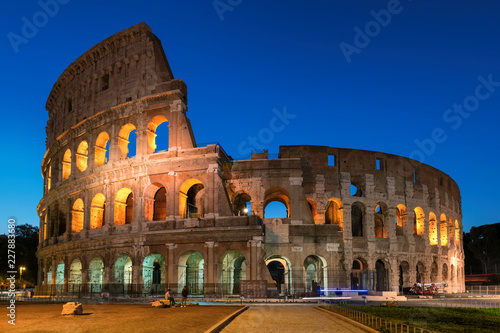 Rome Colosseum in Rome, illumination at night with blue sky, Rome, Italy,