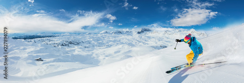 Alpine skier skiing downhill, panoramic format Canvas Print