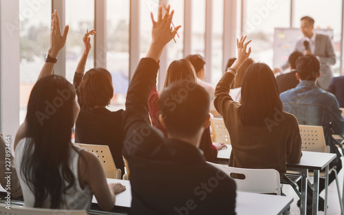 Obraz Raised up hands and arms of large group in seminar class room to agree with speaker at conference seminar meeting room - fototapety do salonu