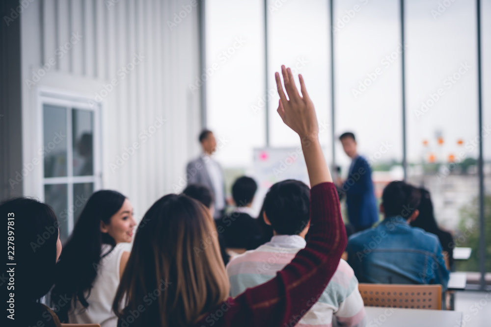 Fototapety, obrazy: Woman raised up hands and arms  in seminar class room to agree with speaker at conference seminar meeting room