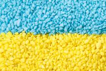 Texture Of Light Blue And Yellow Decorative Pebbles. Ukrainian Flag.