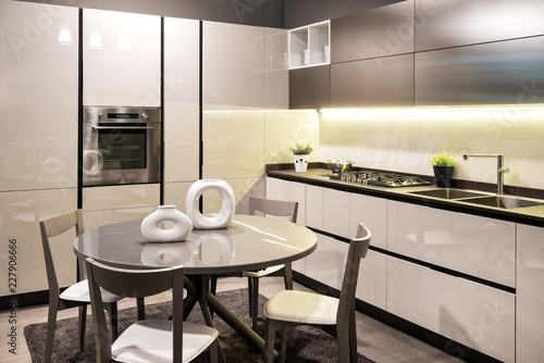 Fényképezés  Modern built in kitchen with circular dining table