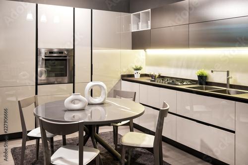 Modern built in kitchen with circular dining table Tapéta, Fotótapéta