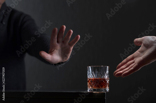 Man with a gesture refuses alcohol.