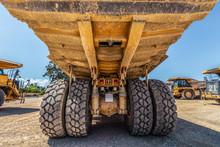 Rear Closeup View Of Huge Dirty Dumper Truck