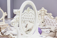 Luxury Mirror In The Furniture Salon. Fashionable And Comfortable Bed Is Reflected In The Mirror